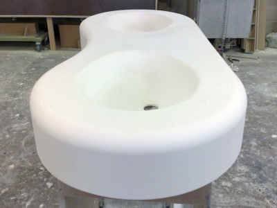 Curved double sink